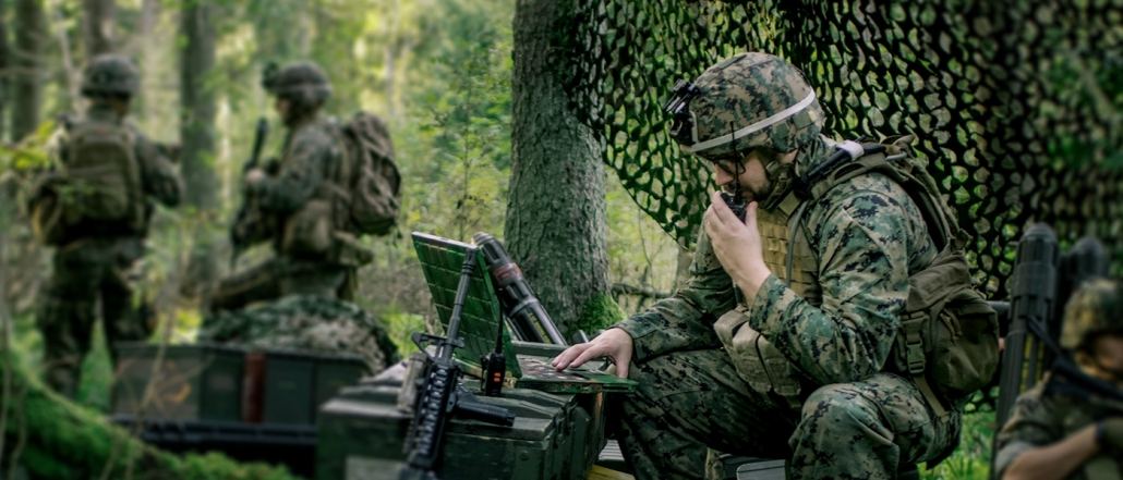 Military Staging Area, Chief Engineer Uses Radio and Army Grade Laptop
